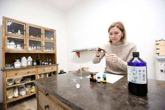Bekki Fishelson Kuber blends an essential oil synergy in her shop at Blue Marble Botanicals in Fond du Lac, Wis. Kuber will be expanding her business into a Main Street location in the spring.