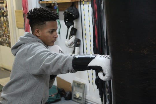 Elijah Karlovetz works out on a heavy bag as he prepares for the national championships being held in Missouri from Thursday through Sunday.