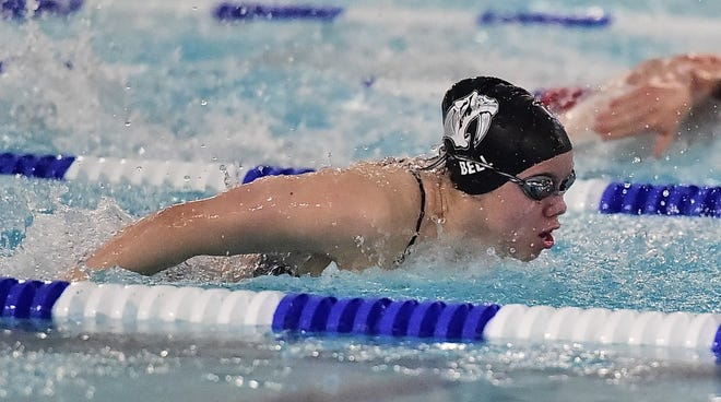 Fossil Ridge High School swimmer Lisa Bell swims the butterfly portion of the 200-yard medley relay Tuesday, Jan. 28, 2020, in the City Swim Meet at Edora Pool Ice Center. Fossil Ridge won the event and the meet.
