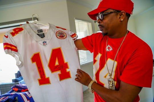 James McMiller looks at a jersey Sammy Watkins gave to him for Christmas. Watkins, a wide receiver for the Kansas City Chiefs, has very proud parents, James McMiller, his stepfather, and Nicole McMiller, his mother. They will head over to Miami to watch Sammy in the Super Bowl on Sunday.