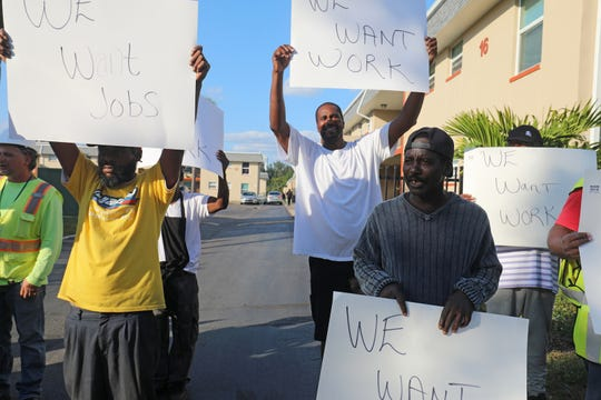 Laborers in need of work protested Tuesday outside Fort Myers' Royal Palm Apartments (formerly Jones Walker) on Blount Street in Fort Myers where a major rehab project began last week without, they say, local worker participation. It is the second such protest in a week.