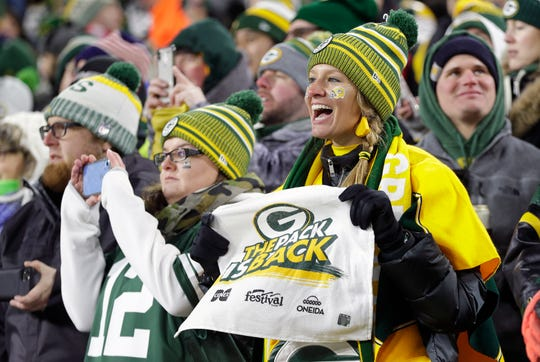 Green Bay Packers fans cheering during the game against the Seattle Seahawks in an NFC divisional playoff game on Jan. 12, 2020.