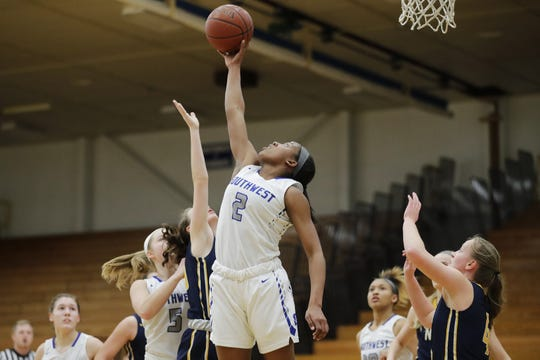 Green Bay Southwest's Jaddan Simmons (2) became the metro's all-time leading girls scorer on Tuesday night.