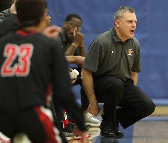 Green Bay East coach Rick Rosinski helped start a Silent Night fundraiser eight years ago.