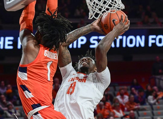 Clemson guard Tevin Mack(13) scores two of his 32 points near Syracuse freshman Quincy Guerrier(1) during the first half at Littlejohn Coliseum Tuesday, January 28, 2020.