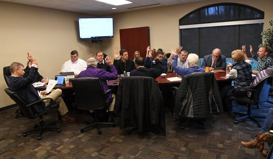 The masterplan steering committee votes during a meeting in Clemson Wednesday. The group discussed hiring a third-party consultant growth at a meeting in the Clemson City Hall.