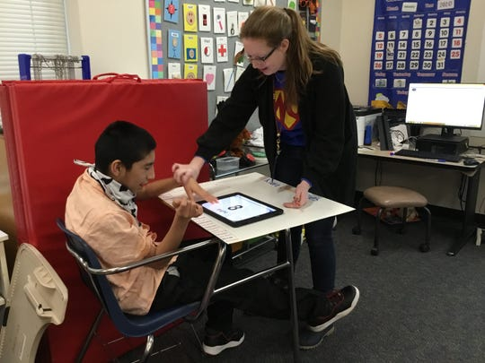 Students at Washington Center use their pen pal relationship with SEC schools to practice math, English, social studies and more.