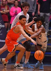 The Dorman Cavaliers take on the Mauldin Mavericks during basketball action held at Dorman High School in Spartanburg, Tuesday evening, January 28, 2020. Dorman's Myles Tate (12) scrambles for a loose ball against Mauldin's Drake Downs (34).