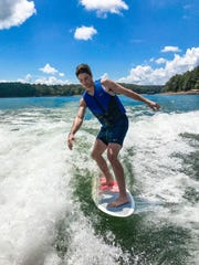 Clemson's Davis Sharpe enjoys a little surfboarding at Lake Hartwell.