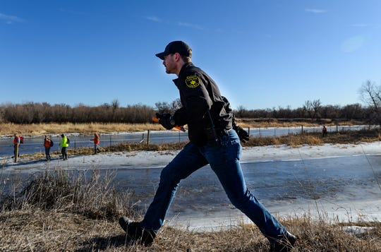 Cascade County Sheriff's Deputy Riley McDermott works a bank of the Missouri River with his group of volunteers during a search effort for Amy Harding-Permann last week. The search continued Thursday as the CCSO used boats to search the river ahead of an expected cold snap this weekend.
