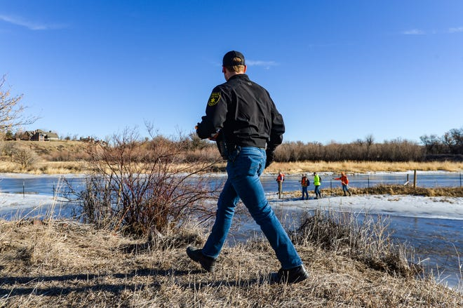 Cascade County Sheriff's Deputy Riley McDermott supervises his group of volunteers during Wednesday's search effort for Amy Harding-Permann who went missing on Sunday night, January 26, 2020.  Over 150 volunteers searched pastures, residences and wooded areas along Flood Road and the Missouri River, Wednesday, South of Great Falls.
