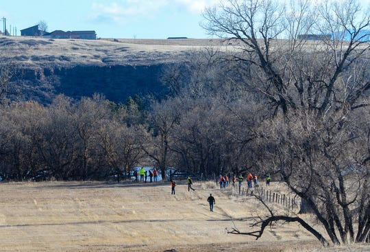 A volunteer search party combs a pasture and a wooded area on the bank of the Missouri River near Woodland Estates, south of Great Falls, as the search continues Wednesday morning for Amy Harding-Permann who was reported missing on Sunday January 26, 2020.