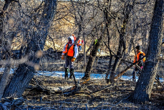 Volunteers search a wooded area on the bank of the Missouri River for Amy Harding-Permann south of Great Falls on Wednesday morning.