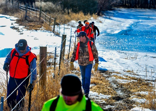 Volunteers navigate the icy banks of a Missouri River side channel as they search for Amy Harding-Permann off of Flood Road south of Great Falls on Wednesday morning.