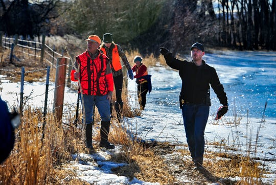 Cascade County Sheriff's Deputy Riley McDermott coordinates with his group of volunteers during Wednesday's search effort for Amy Harding-Permann who went missing on Sunday night, January 26, 2020.  Over 150 volunteers searched pastures, residences and wooded areas along Flood Road and the Missouri River, Wednesday, South of Great Falls.