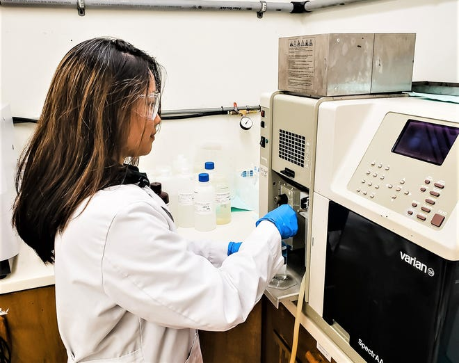 Mallary Duenas, a lab assistant at the UOG Water and Environmental Research Institute, tests a water sample using an atomic absorption spectrophotometer, an analytical instrument used to test lead in drinking water.