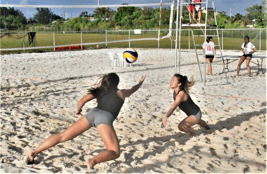A well-placed shot by Academy's Genice Torres sends St. John's Tylee Shepherd, left and Hallie Wigsten diving for the ball during their IIAAG Girls Beach Volleyball match Jan. 28 at the Guam Football Association National Training Center's sand courts. Shepherd/Wigsten won 21-4, 21-4.