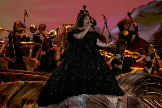 Lizzo performs at the 62nd annual Grammy Awards on Sunday, Jan. 26, 2020, in Los Angeles. Southern Miss alumna Patricia Weitzel, standing far right, joined Lizzo onstage in an all-female orchestra.