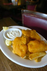 Beer-battered and deep-fried cod with a side of fries and tartar sauce is the classic Scottish fish and chips at MacNiven's, 339 Mass. Ave., Indianapolis.