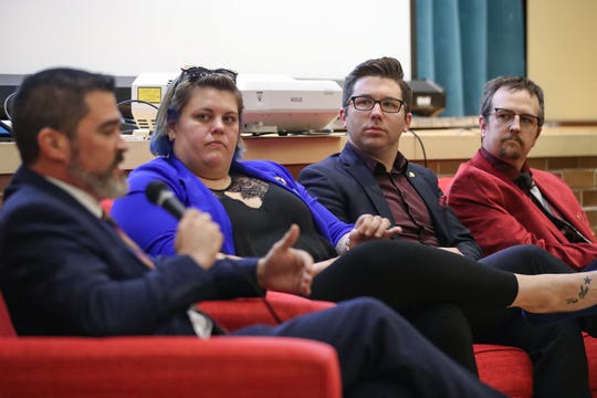 From left, Zach Adamson speaks as Ali Brown, Keith Potts and Ethan Evans listen during a meet and greet at Young and Laramore ad agency in Indianapolis on Tuesday, Jan. 28, 2020. The event, hosted by the Damien Center and Indy Pride, introduced attendees to four recently elected LGBTQ-identifying City-County councilors and offered a chance to ask them questions.
