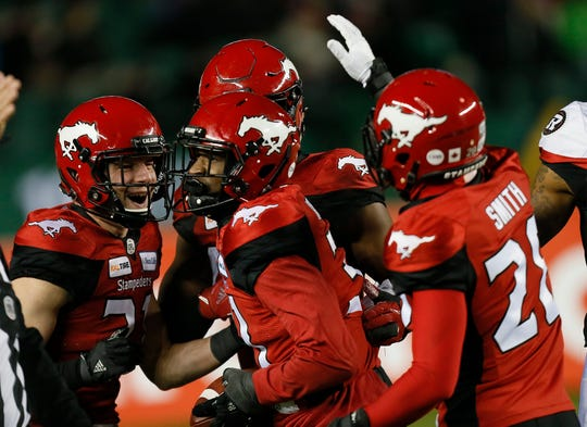 Nov 25, 2018; Edmonton, Alberta, CAN; Calgary Stampeders congratulate Calgary Stampeders defensive back Tre Roberson (31) after an interception against the Ottawa Redblacks during the 106th Grey Cup game at The Brick Field at Commonwealth Stadium. Calgary defeated Ottawa.