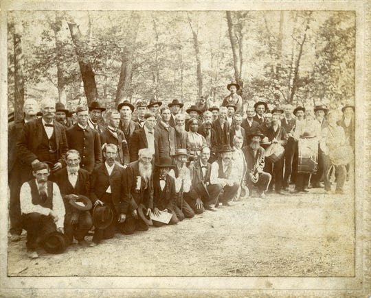 Lucy Higgs Nichols stands in the middle of a group of Civil War and Spanish–American War soldiers and veterans at a reunion in English, Indiana, in 1898.