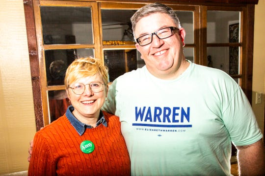 Melissa Fath, an Amy Klobuchar supporter, and her husband Rod Sullivan, an Elizabeth Warren supporter, talk for a photo, Tuesday, Jan. 28, 2020, at their home in Iowa City, Iowa.
