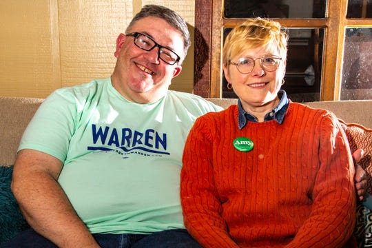 Rod Sullivan, an Elizabeth Warren supporter, and his wife Melissa Fath, an Amy Klobuchar supporter, pose for a photo, Tuesday, Jan. 28, 2020, at their home in Iowa City, Iowa.
