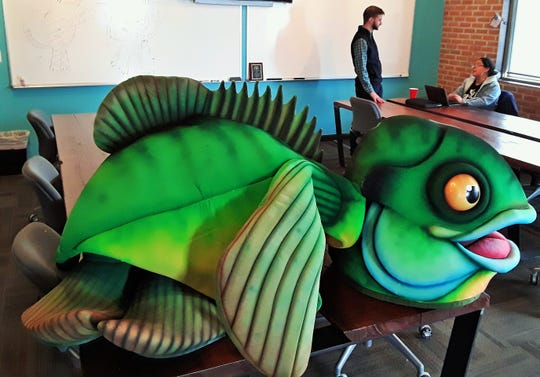"The mascot costume for ""Gill the Bluegill"" could be seen recently in the main co-working space room at North Liberty CoLab. The cleverly-crafted fish suit is used to help educate the public about polluted storm sewer water."
