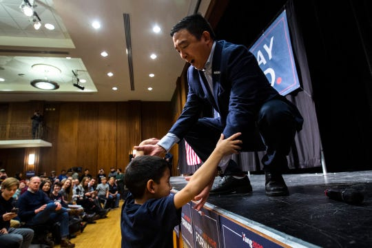 Democratic presidential candidate Andrew Yang picks up his son Christopher during a campaign event, Wednesday, Jan. 29, 2020, at the Iowa Memorial Union second floor ballroom on the University of Iowa campus in Iowa City, Iowa.