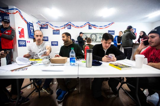 Ian Stranathan, of Canton, Ohio, Musa Jamshed, of San Francisco, Calif., Justin Vovala, of Los Angeles, and Van Yaeger, of Austin, Texas, make phone calls while volunteering, Friday, Jan. 24, 2020, at a field office for Democratic presidential candidate Andrew Yang in Iowa City, Iowa.