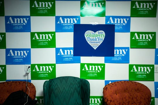 Blue and green signs form a pattern on the wall along with a sign that thanks volunteers, Thursday, Jan. 23, 2020, at a field office for Democratic presidential candidate U.S. Sen. Amy Klobuchar, D-Minn., in Iowa City, Iowa.