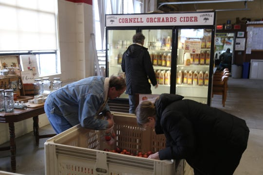 Customers shop at the Cornell Orchards Store.