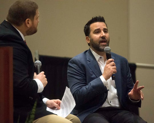 Chris Harris (left), director of communications with the Mississippi Braves, and Alex Anthopoulos (right), general manager of the Atlanta Braves, talk with members of the audience during a Q&A session at the Greater Jackson Chamber Partnership's Vision 2020 event at the Jackson Convention Complex on Wednesday, Jan. 29, 2020.