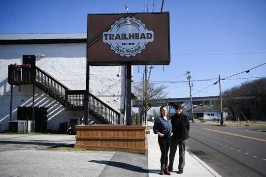 Corey Everett, general manager of Trailhead Beer Market's new location, and  Kathy Wright, an owner of Trailhead Beer Market,  pose for a photo outside their original South Knoxville location on Sevier Avenue, Tuesday, Jan 28, 2020. They will open a second location on Sutherland Avenue in the building Third Creek Coffee recently inhabited.