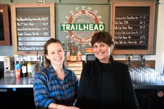 Corey Everett, general manager of Trailhead Beer Market's new location, and  Kathy Wright, an owner of Trailhead Beer Market, pose for a photo in their original South Knoxville location on Sevier Avenue, Tuesday, Jan 28, 2020. They will open a second location on Sutherland Avenue in the building Third Creek Coffee recently inhabited.