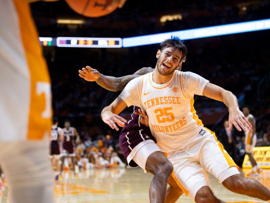 Tennessee guard Santiago Vescovi (25) moves past a Texas A&M defender to inbound the ball during a basketball game between theTennessee Volunteers and the Texas A&M Aggies at Thompson-Boling Arena in Knoxville, Tenn., on Tuesday, January 28, 2020.