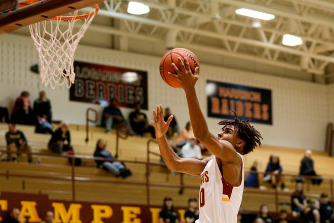 McCutcheon guard Joe Phinisee (0) goes up for a layup during the second quarter of an IHSAA boys basketball game, Tuesday, Jan. 28, 2020 in Lafayette.