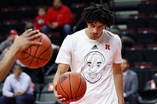 Wearing a T-shirt in tribute to former Los Angeles Lakers star Kobe Bryant, Rutgers guard Geo Baker handles the ball while warming up for the team's NCAA college basketball game against Purdue, Tuesday, Jan. 28, 2020, in Piscataway, N.J. Bryant and his daughter Gianna, 13, died along with seven others in a helicopter crash Sunday while traveling to his daughter's basketball practice in California.