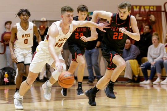 McCutcheon guard Rowen Farrell (14) dribbles down the court against Clinton Prairie's Trevor Funk (22) during the third quarter of an IHSAA boys basketball game, Tuesday, Jan. 28, 2020 in Lafayette.