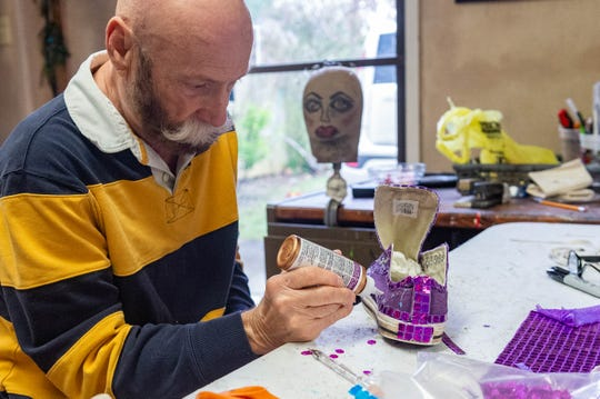 Jimmy Pool puts the final pieces on a performers shoes, providing a behind the scenes look at the design and fabrication of the elaborate costumes for the Apollo Ball. Wednesday, Jan. 29, 2020.