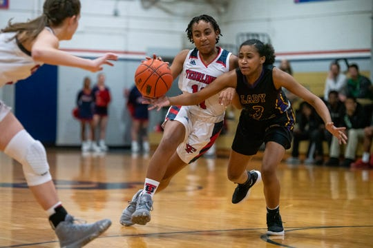 Teurlings Catholic's Haleigh Thomas drives the ball down the court as the Rebels take on the Westgate High Tigers on Tuesday, Jan. 28, 2020.