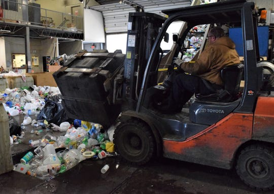 Josh Brown uses a forklift to dump recyclable materials onto the conveyor belt at the Lancaster-Fairfield Community Action Agency Recycling Center on E Main Street in Lancaster. According to the agency's recycling and litter prevention director, new changes are coming in the future to improve the center's operations.