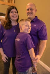 Cheryl Wegener, her husband, Rob, and son, Matthew, in their Hamburg Township home Tuesday, Jan. 28, 2020. The family continues to wear purple, a favorite color of Matthew's sister, Madison, who died of pulmonary hypertension Jan. 21.