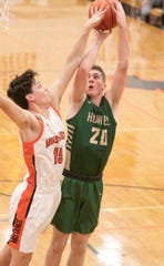 Howell's JD Dell scores while guarded by Northville's Jack Huddy on Tuesday, Jan. 28, 2020.