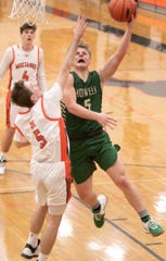 Howell's Peyton Ward scores two of his career-high 11 points while defended by Northville's Grant Mathiesen on Tuesday, Jan. 28, 2020.