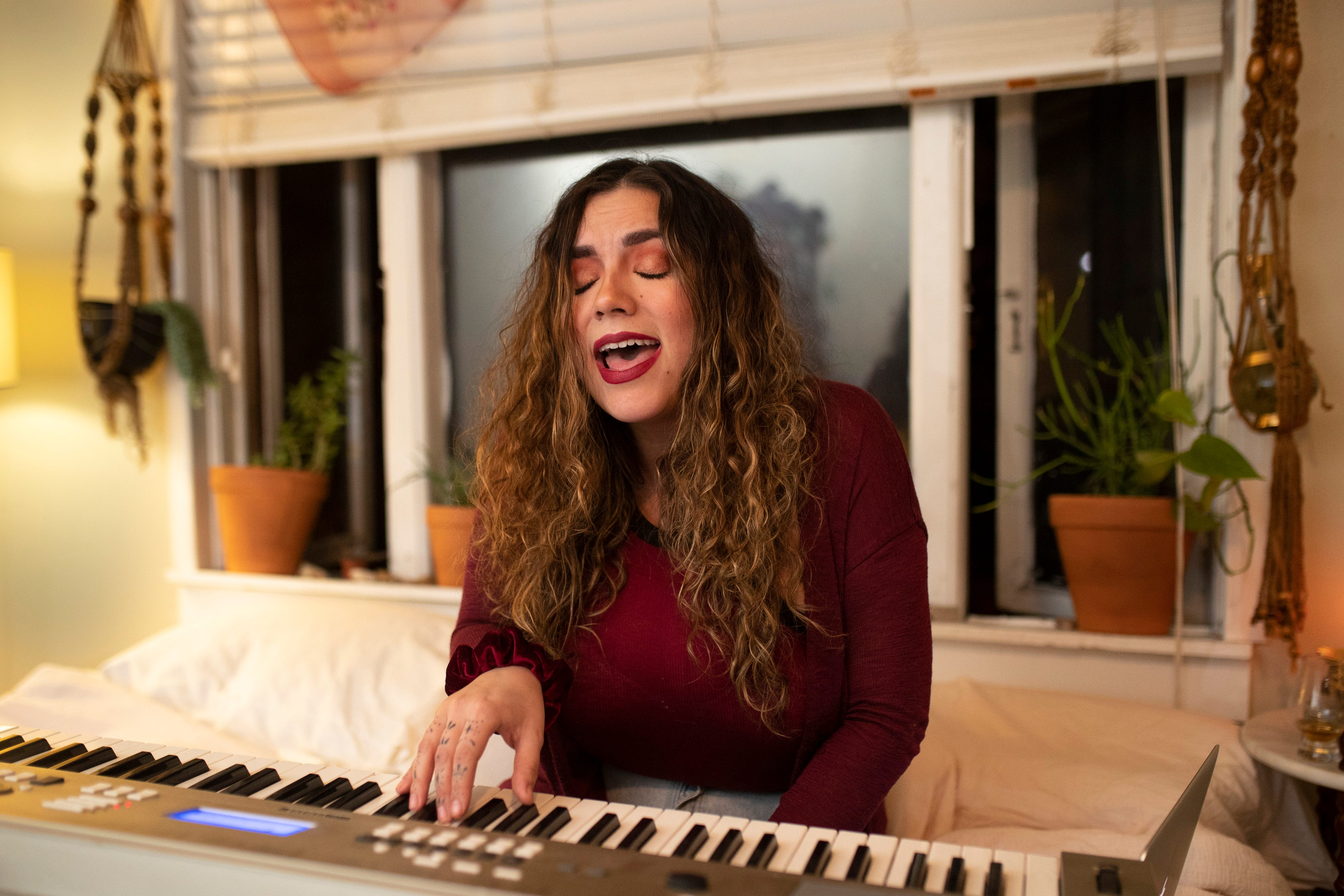"""10:54 PM  Louisville artist and musician Jordan Blase practices her original songs in her bedroom before bandmates came to her apartment for a rehearsal of their upcoming EP PYRO on Jan. 23, 2020. """"I started singing when I was young, I had a bad speech impediment and I could sing better than I could talk,"""" Blase said. """"It was just a way for me to practice my speech alone and not feel weird about how I said anything."""" Today, Blase freely belts out vocals in front of live audiences and is excited to share songs that she's had in the works for some time. """"Music is just a need now, like something I have to expel."""""""