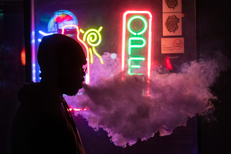 1:17 AMDez Milliner-Bryant exhales a cloud of smoke as he vapes outside Akikos karaoke bar on a chilly night on Bardstown Road in Louisville on Jan. 17, 2020.