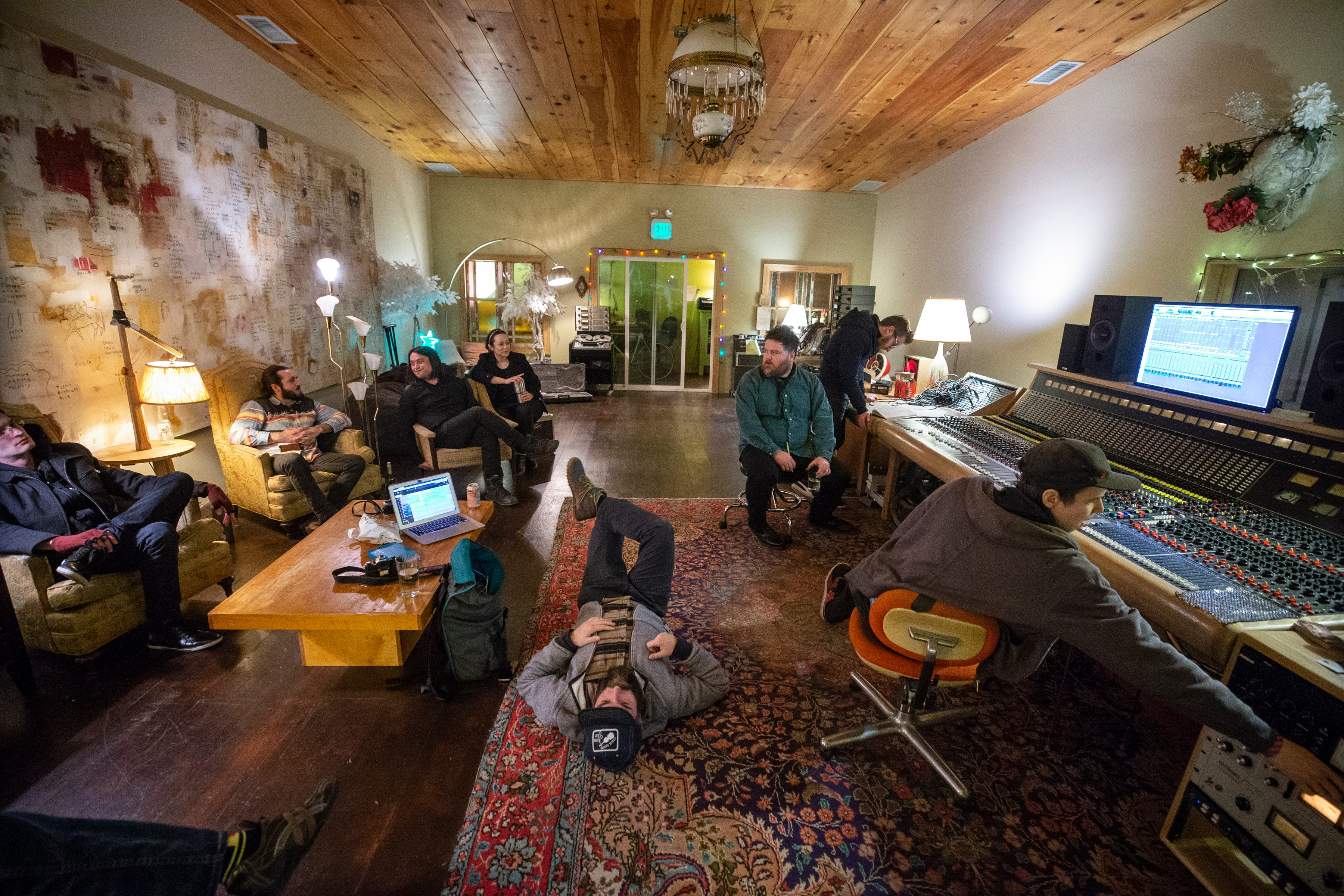 12:54 AM  Anne Gauthier, right, head engineer at La La Land Studio made an adjustment while members and friends of the band Drew Miller & Curiokey Club listened to the playback of a recording on Jan. 19, 2020