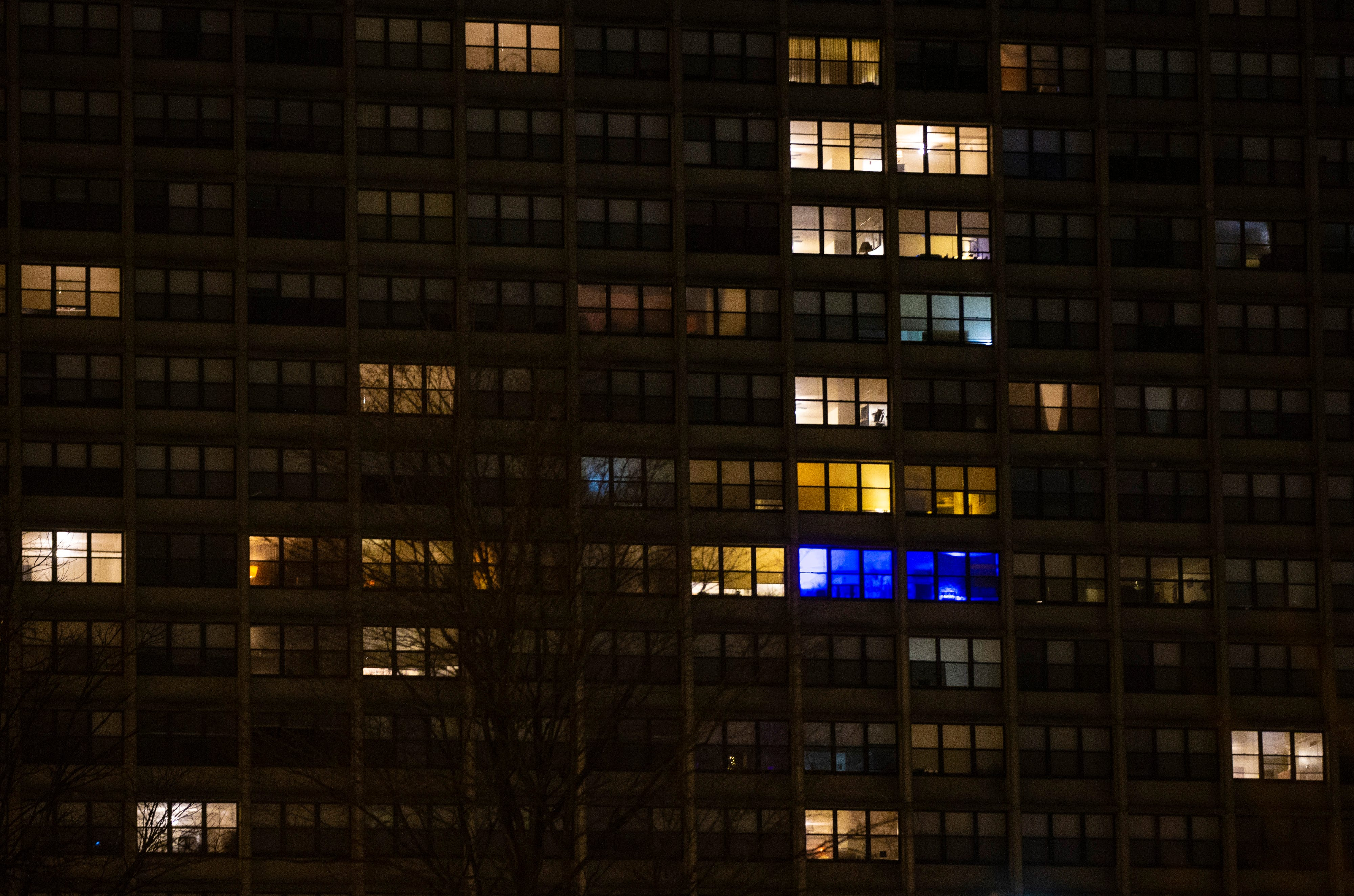2:09 AMAn apartment is illuminated by blue lighting among the other tungsten lit apartments just off of Ninth Street on Jan. 26, 2020.